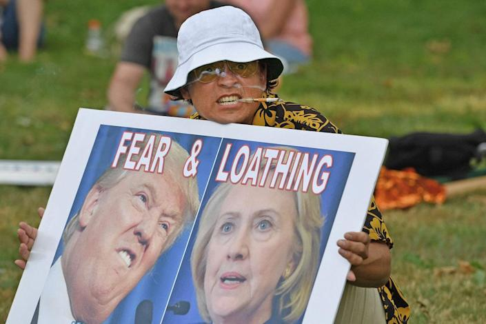 <p>A man dressed like author Hunter S. Thompson holds a sign before the start of the Democratic National Convention (DNC) on July 24, 2016 in Philadelphia, Pennsylvania. (Jeff J Mitchell/Getty Images)</p>