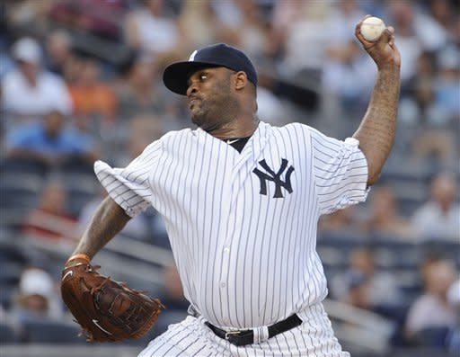 New York Yankees starting pitcher CC Sabathia throws to a Seattle Mariners batter in the second inning of a baseball game Friday, Aug. 3, 2012, at Yankee Stadium in New York. (AP Photo/Kathy Kmonicek)