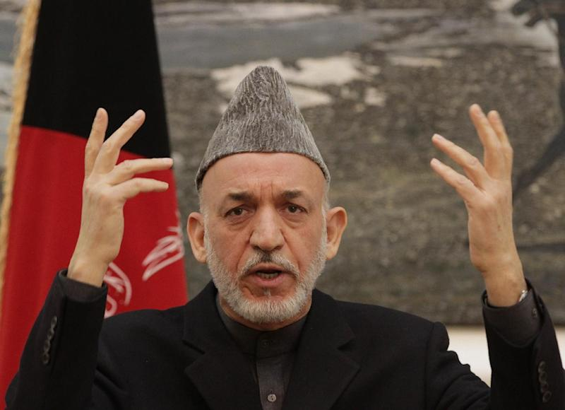 Afghan president Hamid Karzai gestures during a press conference at the presidential palace in Kabul Afghanistan, Saturday, Dec. 8, 2012. Karzai said Saturday that Thursday's assassination attempt on the country's intelligence chief was planned in neighboring Pakistan but he did not provide any evidence to back up his claim, and was careful not to accuse the Pakistani government of having any role in the suicide attack. (AP Photo/Ahmad Jamshid)