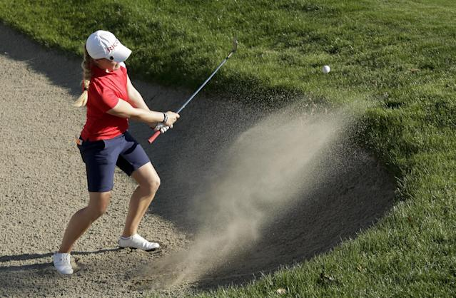 Charley Hull, of England, hits from a bunker on the 16th hole during the third round of the Kraft Nabisco Championship golf tournament on Saturday, April 5, 2014, in Rancho Mirage, Calif. (AP Photo/Chris Carlson)