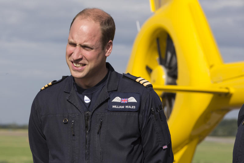Britain's Prince William, the Duke of Cambridge, starts his final shift with the East Anglian Air Ambulance based out of Marshall Airport, near Cambridge, England, Thursday, July 27, 2017. The heir to the British throne is working the night shift at the East Anglian Air Ambulance, where he has been flying medical crews to emergencies such as traffic accidents for about two years. (Heathcliff O'Malley/Pool Photo via AP)