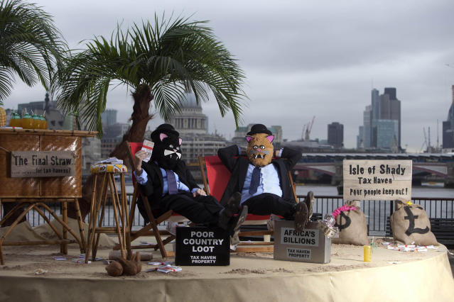 EDITORIAL USE ONLYLuke Harman (left) and Mark Webber, dressed as 'fat-cats', sit on The Isle of Shady, a pop-up tax haven set up by Enough Food for Everyone IF campaigners, sits on the South Bank of the river Thames at Gabriel's Wharf in London ahead of the Open for Growth: Tax, Trade and Transparency event on 15th June and the G8 summit. PRESS ASSOCIATION Picture date: Friday June 14, 2013. Enough Food for Everyone IF is a coalition of more than 200 organisations working together to ensure that governments tackle causes of the global hunger crisis in the year that the UK Government hosts the G8 leaders. Photo credit should read: David Parry/PA Wire