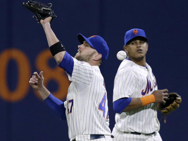 New York Mets center fielder Juan Lagares, right, watches as right fielder Andrew Brown drops San Francisco Giants' Gregor Blanco's fourth-inning pop fly in during a baseball game on Wednesday, Sept. 18, 2013, in New York. (AP Photo/Kathy Willens)