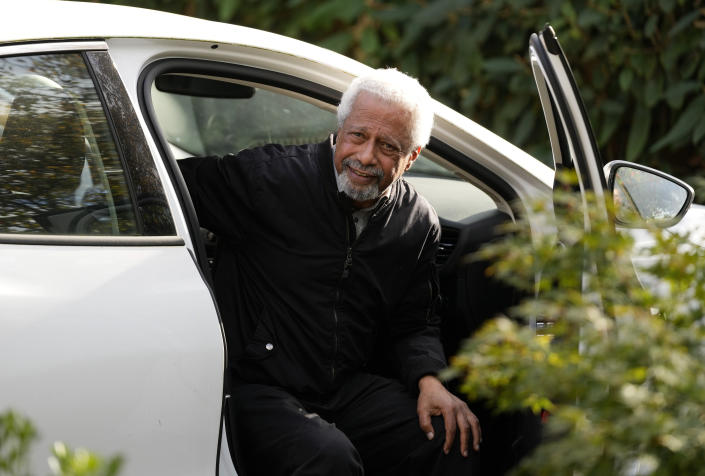 """Tanzanian writer Abdulrazak Gurnah arrives back at his home in Canterbury, England, Thursday, Oct. 7, 2021. Gurnah was awarded the Nobel Prize for Literature earlier on Thursday. The Swedish Academy said the award was in recognition of his """"uncompromising and compassionate penetration of the effects of colonialism."""" (AP Photo/Frank Augstein)"""