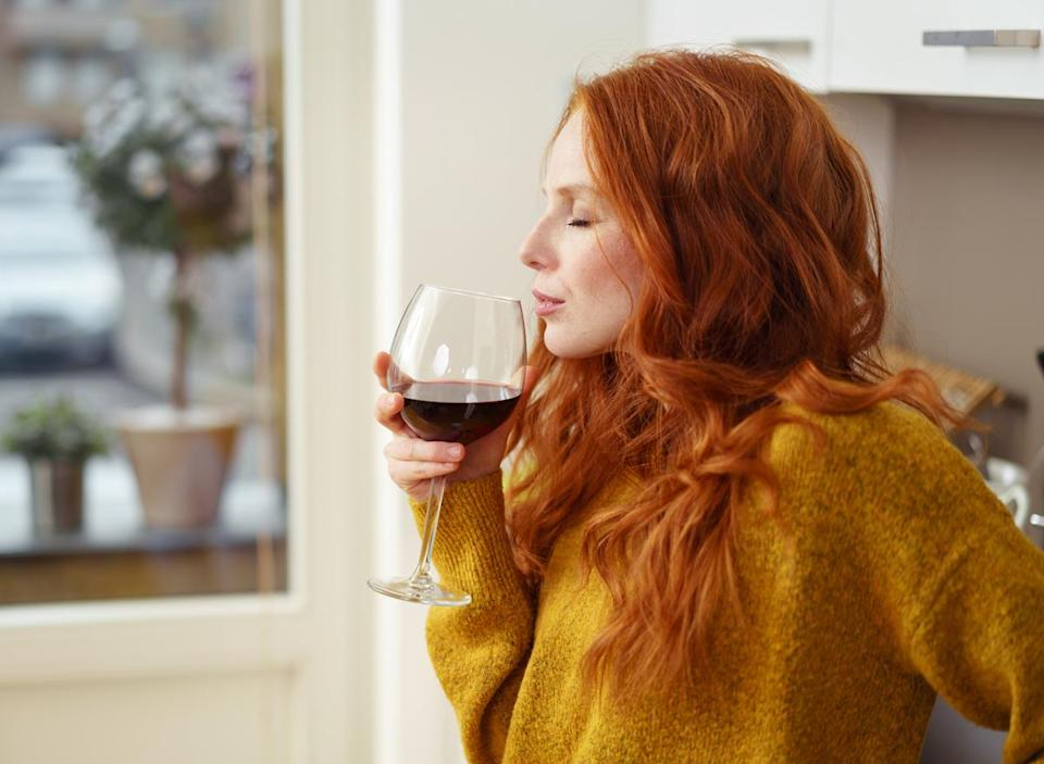 woman drinking wine alcohol at home