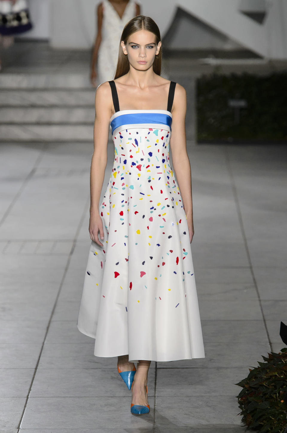 <p><i>A model wears a white, confetti-decorated dress from the SS18 Carolina Herrera dress. (Photo: IMAXtree) </i></p>