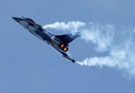 FILE PHOTO - French fighter jet Rafale made by Dassault performs during the Breitling Airshow in Sion, Switzerland September 15, 2017. REUTERS/Denis Balibouse