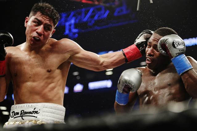 Jessie Vargas, left, punches Adrien Broner during the fourth round of their welterweight boxing match April 21, 2018, in New York. (AP)
