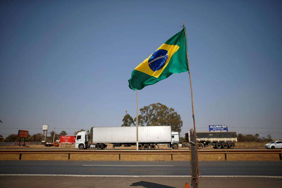 A truck passes a gas station near BR-040 highway, during the truckers' protest in support of Brazilian President Jair Bolsonaro in Valparaiso de Goias, Goias State, Brazil September 9, 2021. REUTERS/Adriano Machado