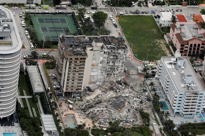 An aerial view showing a partially collapsed building in Surfside near Miami Beach, Florida, U.S., June 24, 2021. REUTERS/Marco Bello