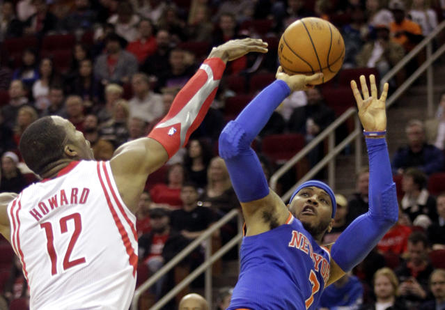 Carmelo Anthony shoots over Dwight Howard, four and a half years and a couple of lifetimes ago. (AP)