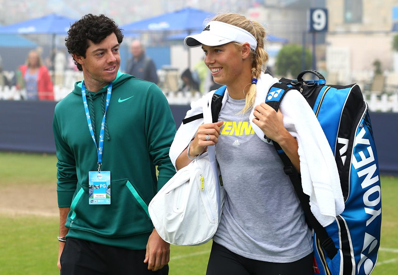 EASTBOURNE, ENGLAND - JUNE 20: Rory McIlroy and girlfriend Caroline Wozniacki leave the practice court during day six of the AEGON International tennis tournament at Devonshire Park on June 20, 2013 in Eastbourne, England. (Photo by Jan Kruger/Getty Images)