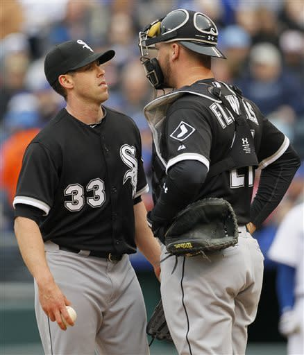 Chicago White Sox pitcher Dylan Axelrod (33) talks to catcher Tyler Flowers, right, after the Kansas City Royals scored two runs in the first inning during a baseball game at Kauffman Stadium in Kansas City, Mo., Saturday, May 4, 2013. (AP Photo/Colin E. Braley)