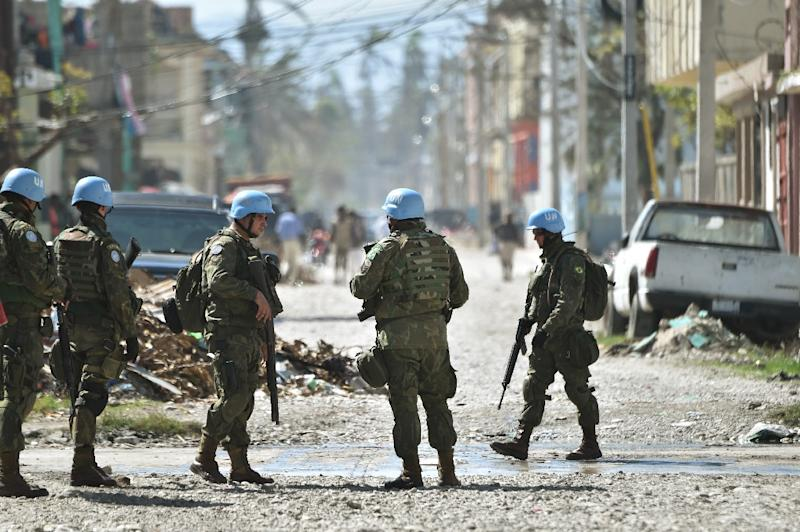 The UN Stabilization Mission in Haiti, known by its French acronym MINUSTAH, is now 13 years old (AFP Photo/HECTOR RETAMAL)