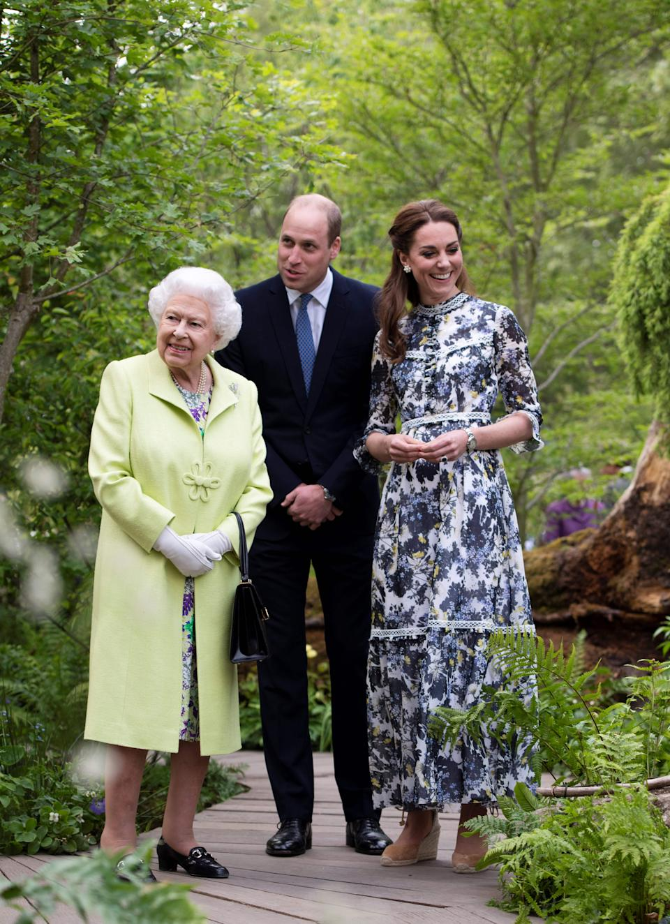 Britain's Catherine, Duchess of Cambridge (R) shows Britain's Queen Elizabeth II (L) and Britain's Prince William, Duke of Cambridge, around the 'Back to Nature Garden' garden, that she designed along with Andree Davies and Adam White, during their visit to the 2019 RHS Chelsea Flower Show in London on May 20, 2019. - The Chelsea flower show is held annually in the grounds of the Royal Hospital Chelsea. (Photo by Geoff Pugh / POOL / AFP)        (Photo credit should read GEOFF PUGH/AFP via Getty Images)