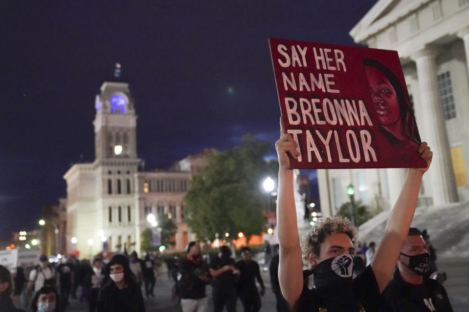 Protesters march, Thursday, Sept. 24, 2020, in Louisville, Ky. Authorities pleaded for calm while activists vowed to fight on Thursday in Kentucky's largest city, where a gunman wounded two police officers during anguished protests following the decision not to charge officers for killing Breonna Taylor. (AP Photo/John Minchillo)