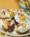"""<p>Treat your football crew to these amazing baked potatoes inspired by pasta carbonara. The soft yolk is the perfect partner to the fluffy potato underneath.</p><p><strong><a href=""""https://www.thepioneerwoman.com/food-cooking/recipes/a33548820/carbonara-baked-potatoes-recipe/"""" rel=""""nofollow noopener"""" target=""""_blank"""" data-ylk=""""slk:Get the recipe."""" class=""""link rapid-noclick-resp"""">Get the recipe.</a></strong></p><p><strong><a class=""""link rapid-noclick-resp"""" href=""""https://go.redirectingat.com?id=74968X1596630&url=https%3A%2F%2Fwww.walmart.com%2Fbrowse%2Fhome%2Fthe-pioneer-woman-plates%2F4044_623679_639999_2113437_9360029&sref=https%3A%2F%2Fwww.thepioneerwoman.com%2Ffood-cooking%2Fmeals-menus%2Fg35049189%2Fsuper-bowl-food-recipes%2F"""" rel=""""nofollow noopener"""" target=""""_blank"""" data-ylk=""""slk:SHOP PLATES"""">SHOP PLATES</a><br></strong></p>"""