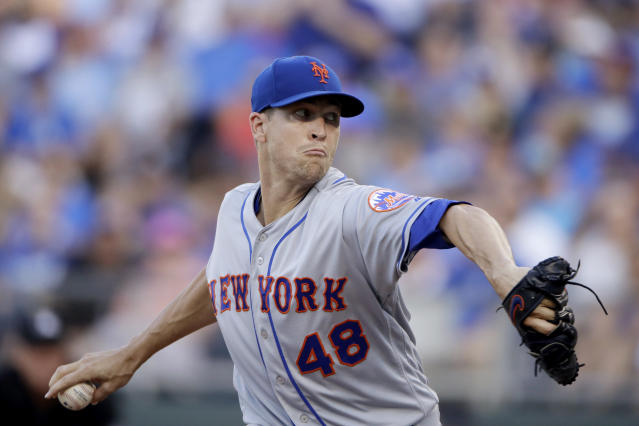 New York Mets starting pitcher Jacob deGrom throws during the first inning of the team's baseball game against the Kansas City Royals on Saturday, Aug. 17, 2019, in Kansas City, Mo. (AP Photo/Charlie Riedel)