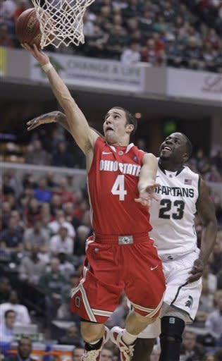 Ohio State guard Aaron Craft (4) goes up for a basket against Michigan State forward Draymond Green (23) in the first half of an NCAA college basketball game in the final of the Big Ten Conference men's tournament in Indianapolis, Sunday, March 11, 2012. (AP Photo/Michael Conroy)