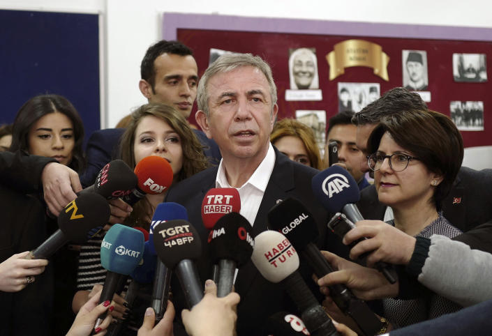 Mansur Yavas, the Ankara mayoral candidate of Turkey's main opposition alliance talks to the media after he casts his ballot at a polling station during the local elections in Ankara, Turkey, Sunday, March 31, 2019. Turkish citizens have begun casting votes in municipal elections for mayors, local assembly representatives and neighborhood or village administrators that are seen as a barometer of Erdogan's popularity amid a sharp economic downturn. (AP Photo/Burhan Ozbilici)