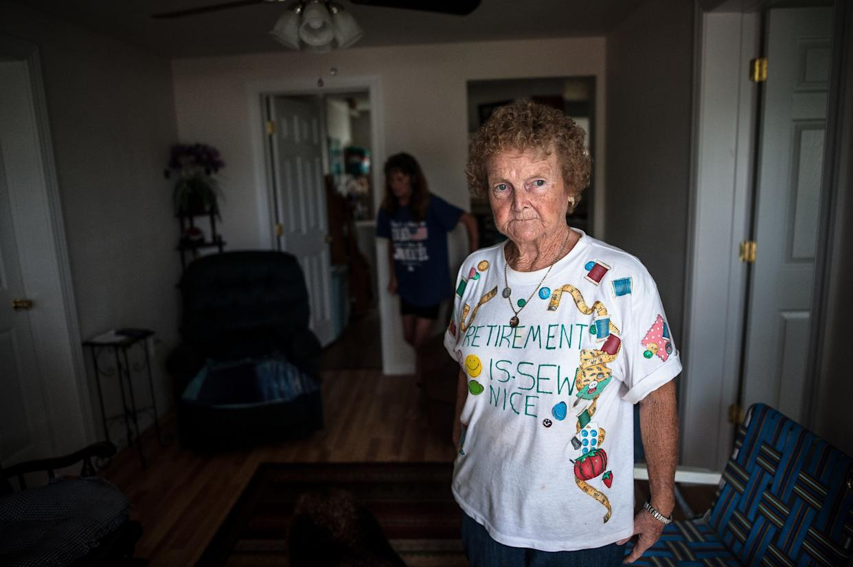 Linda Prevatte and Mary Jane Allen stand in their home in Lumberton, watching floodwaters rise and deciding whether to evacuate.