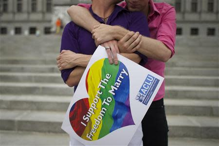 A couple embraces on the Pennsylvania State Capital steps following a rally with gay rights supporters in Harrisburg
