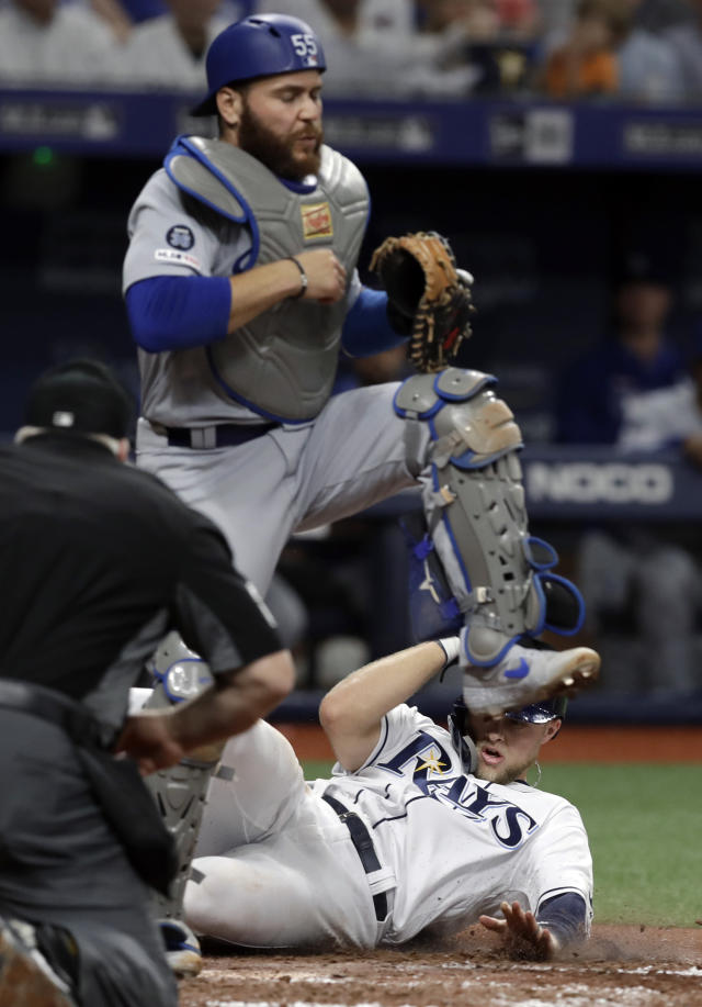 Tampa Bay Rays' Austin Meadows, bottom, scores ahead the throw to Los Angeles Dodgers catcher Russell Martin on a single by Brandon Lowe during the seventh inning of a baseball game Wednesday, May 22, 2019, in St. Petersburg, Fla. (AP Photo/Chris O'Meara)