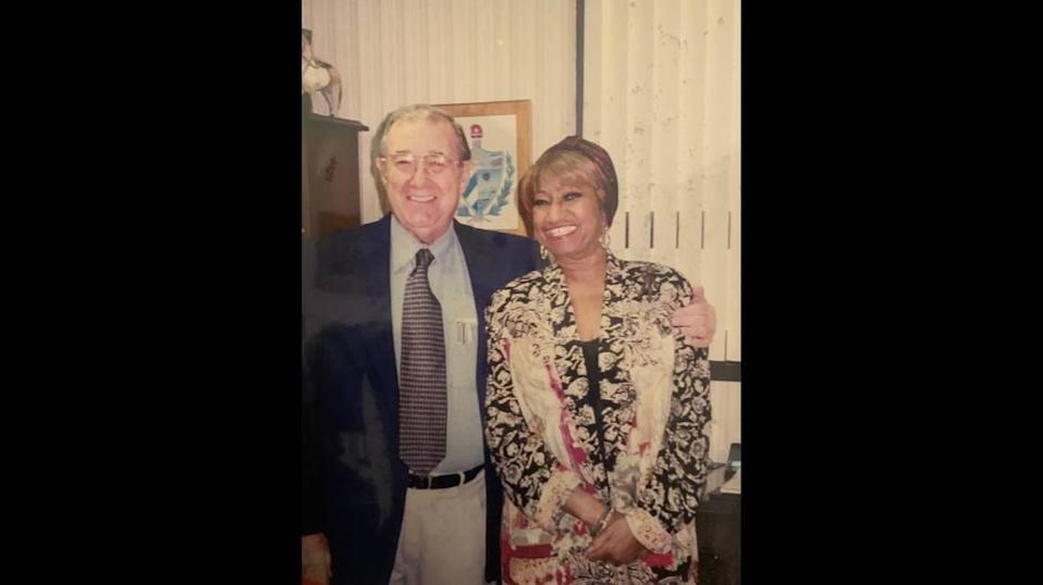 Dr. Jorge A. Vallejo poses in 1992 with Cuban salsa icon Celia Cruz, whom he had treated as a patient. Vallejo, 89, died on June 27, 2020, from complications stemming from COVID-19.