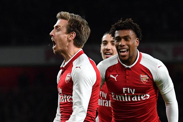 "<a class=""link rapid-noclick-resp"" href=""/soccer/players/nacho-monreal/"" data-ylk=""slk:Nacho Monreal"">Nacho Monreal</a> celebrates <a class=""link rapid-noclick-resp"" href=""/soccer/teams/arsenal/"" data-ylk=""slk:Arsenal"">Arsenal</a>'s first goal, which found its way into the net after deflections off of two <a class=""link rapid-noclick-resp"" href=""/soccer/teams/chelsea/"" data-ylk=""slk:Chelsea"">Chelsea</a> heads. (Getty)"