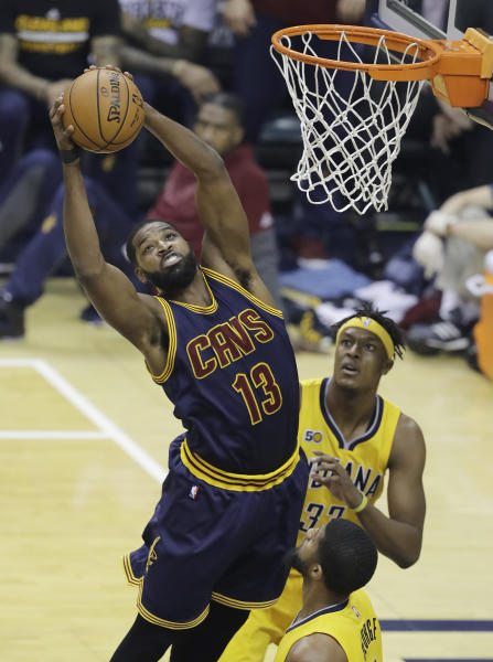 Cleveland Cavaliers' Tristan Thompson grabs a rebound above Indiana Pacers' Myles Turner, rear, during the first half in Game 3 of a first-round NBA basketball playoff series, Thursday, April 20, 2017, in Indianapolis. (AP Photo/Darron Cummings)