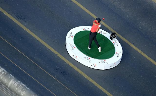 ISTANBUL, TURKEY - NOVEMBER 05: Tiger Woods of the USA the World Number One makes history as he hits the first golf shots from East to West on Istanbul's iconic Bosphorus Bridge linking Asia and Europe on November 5, 2013 in Istanbul, Turkey. (Photo by David Cannon/Getty Images)