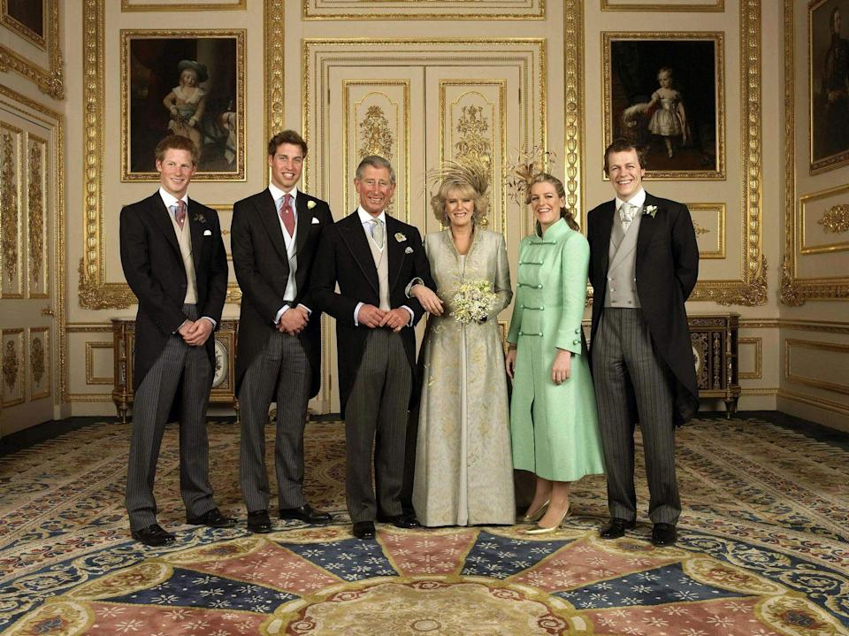 <p>Prince Charles and Camilla chose this sweet family photograph, taken at their wedding in April 2005, for their Christmas card. The photograph features Prince Harry, Prince William, and their step-sister Laura and step-brother Tom Parker Bowles. It was taken in the White Drawing Room at Windsor Castle. </p>