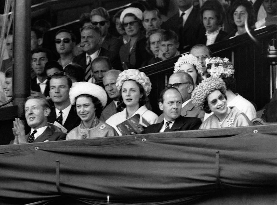<p>The Queen and Princess Margaret cheer from the Royal Box.</p>