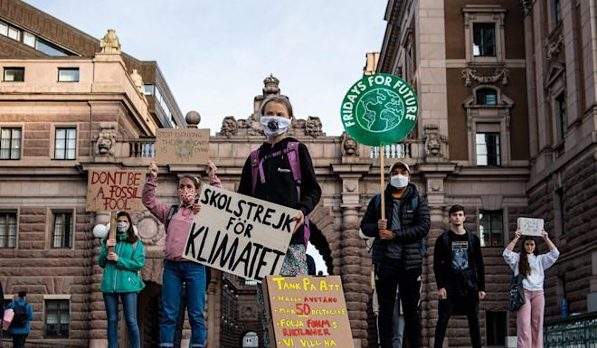 Swedish climate activist Greta Thunberg (centre) takes part in a Fridays For Future protest in front of the Swedish Parliament in Stockholm on September 25, 2020. Photo: AFP
