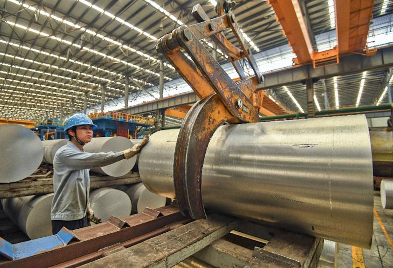 Last year Washington and Beijing slapped tariffs on more than $360 billion in two-way trade, biting into their manufacturing sectors (AFP Photo/STR)