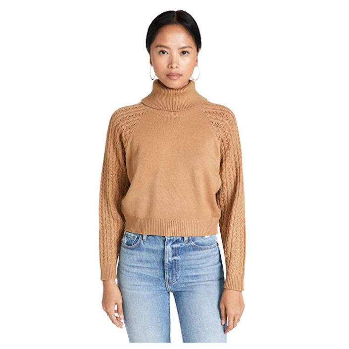 """At first glance, you might not notice the cable-knit detailing on the sleeves of this turtleneck sweater, but it adds a dramatic touch. With a loose-fitting torso, it can easily be layered with a cami underneath for chillier days. $89, Amazon. <a href=""""https://www.amazon.com/BB-Dakota-Steve-Madden-Sweater/dp/B0924VM93Z"""" rel=""""nofollow noopener"""" target=""""_blank"""" data-ylk=""""slk:Get it now!"""" class=""""link rapid-noclick-resp"""">Get it now!</a>"""