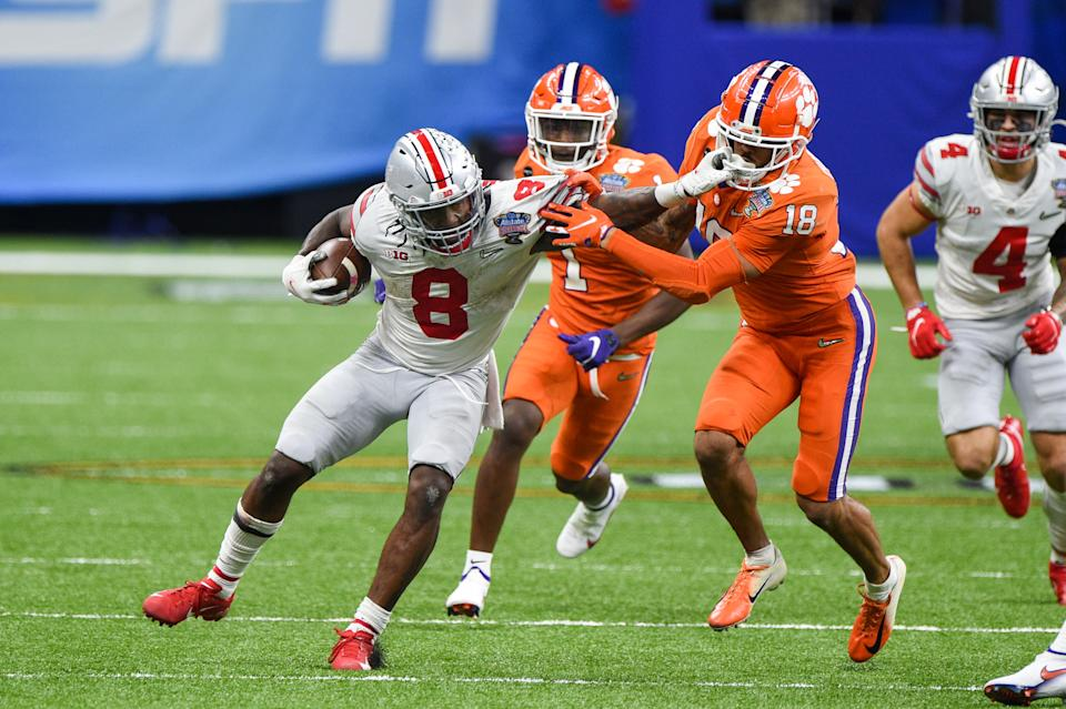 Ohio State Buckeyes RB Trey Sermon (8) attempts to breaks a tackle attempt by Clemson Tigers safety Joseph Charleston (18) during the Sugar Bowl on Jan. 1. (Ken Murray/Icon Sportswire via Getty Images)
