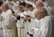 Priests receive the blessing during a Chrism Mass celebrated by Pope Francis inside St. Peter's Basilica, at the Vatican, Thursday, April 18, 2019. During the Mass the Pontiff blesses a token amount of oil that will be used to administer the sacraments for the year. (AP Photo/Alessandra Tarantino)