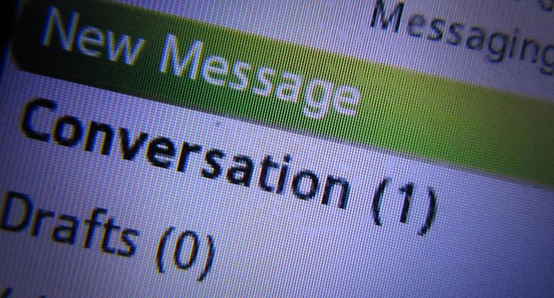 Stock image of a mobile phone screen displaying a new text message.