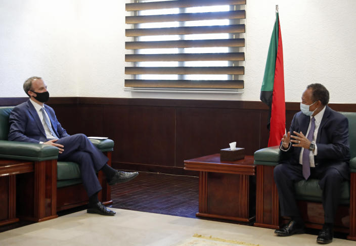 Sudanese Prime Minister Abdullah Hamdok, right, meets with British Foreign Secretary, Dominic Raab in the Cabinet Building, in Khartoum, Sudan, Thursday, Jan. 21, 2021. Raab was in the Sudanese capital Thursday to discuss bilateral relations and tensions along the border with Ethiopia, Sudan's state news agency reported. (AP Photo)