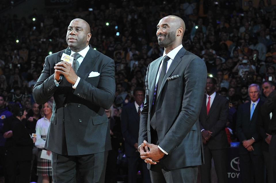 LOS ANGELES, CA - DECEMBER 18:  Magic Johnson speaks at Kobe Bryant's jersey retirement ceremony during halftime of a basketball game between the Los Angeles Lakers and the Golden State Warriors at Staples Center on December 18, 2017 in Los Angeles, California.  (Photo by Allen Berezovsky/Getty Images)
