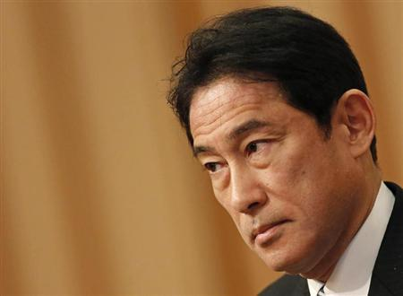 Japan's FM Kishida listens to questions from a participant during a seminar in Tokyo