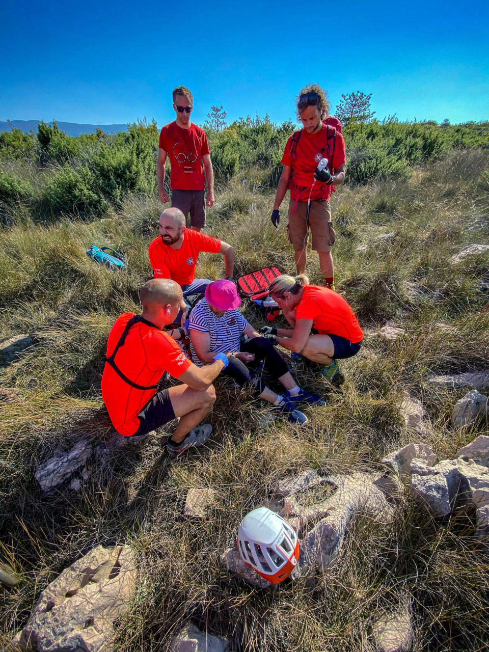 This photo provided by the Croatian Mountain Rescue Service, shows the rescue operation of an unidentified woman who was found on the Adriatic island of Krk on Sept. 12, 2021. Croatian police said Tuesday, Sept. 21, 2021 they are still working to establish the identity of a woman found over a week ago at a northern Adriatic Sea island with no recollection of who she is or where she came from. Police told the Associated Press they are searching the terrain and conducting numerous interviews with residents and tourists or anyone who has information about the woman discovered on the island of Krk on Sept. 12. (Croatian Mountain Rescue Service via AP)