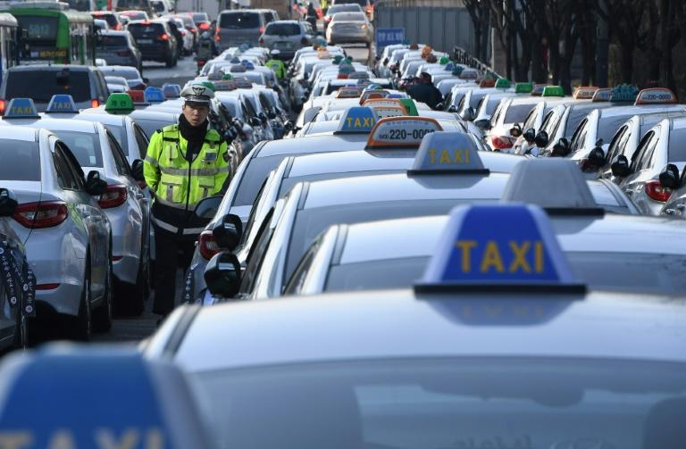 Taxi drivers in South Korea have protested against ride-hailing apps, saying they threaten livelihoods