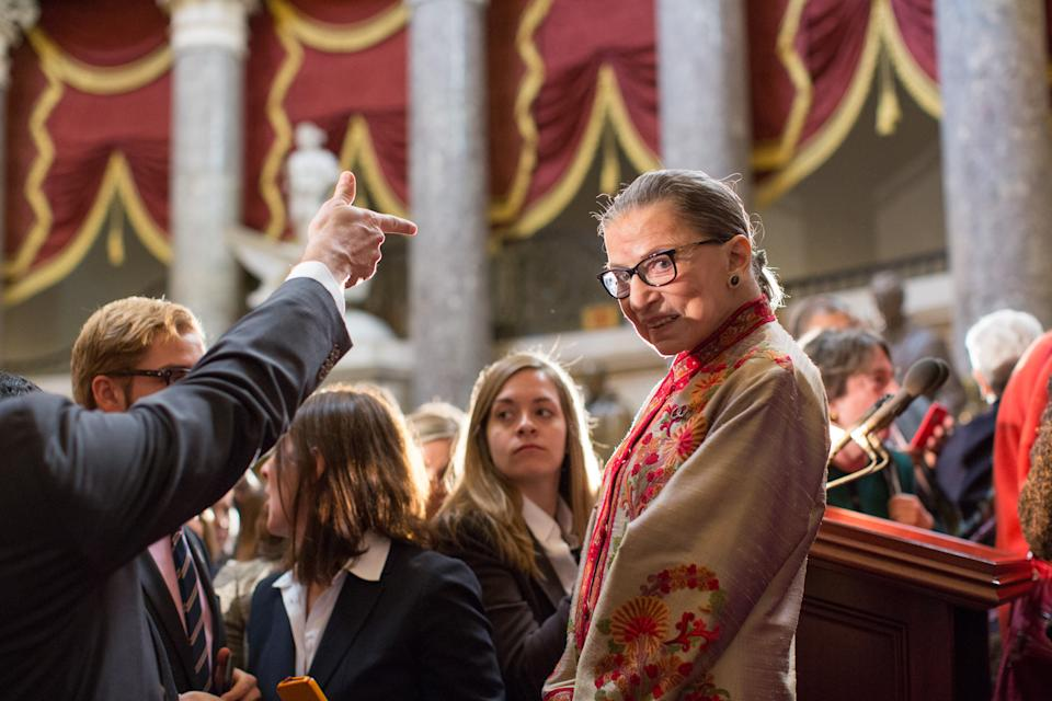 Ginsburg greets participants at an annual Women's History Month reception hosted by Nancy Pelosi on Capitol Hill. (Photo: Allison Shelley/Getty Images)