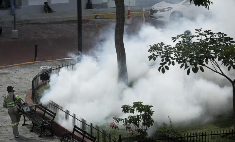 In this photo taken on Sept. 6, 2019, a Panama Ministry Health worker fumigates an area near a public park to prevent against the mosquito-spread virus that transmits dengue fever in Panama City. As a region, Central America and Mexico have already recorded nearly double the number of dengue cases as in all the previous year. (AP Photo/Arnulfo Franco)