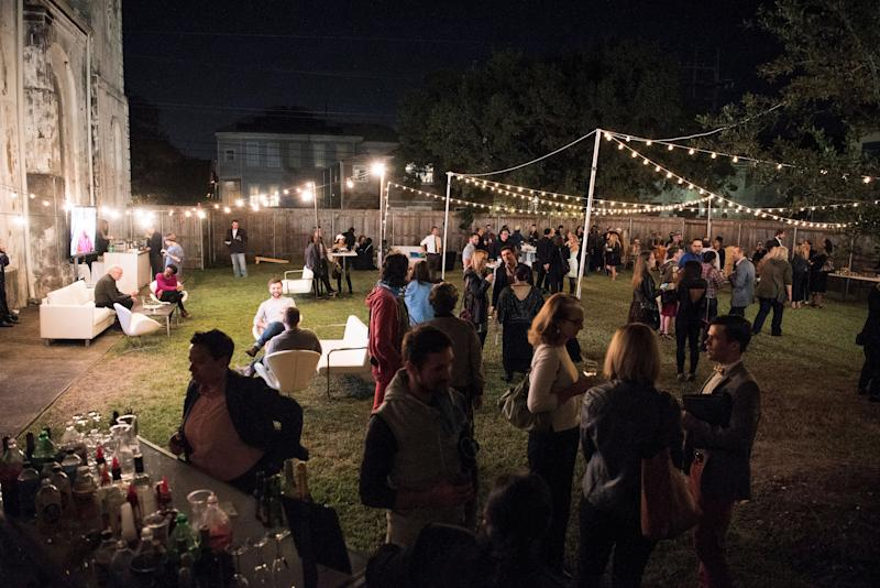 Guests mingle in the garden of Marigny Opera House.