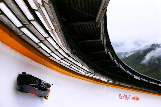 SOCHI, RUSSIA - APRIL 27: Daniil Kvyat of Russia and Red Bull Racing's personal trainer Pyry Salmela and Simon Lazenby of Sky Sports ride in a bobsleigh during previews to the Formula One Grand Prix of Russia at Sanki Sliding Centre on April 27, 2016 in Sochi, Russia. (Photo by Dan Istitene/Getty Images)