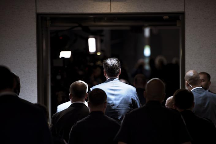 Former FBI Director James Comey walks to a closed-door hearing before the Senate Select Committee on Intelligence on June 8, 2017.