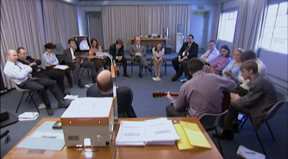 The cast of The Office assemble for training. (BBC)